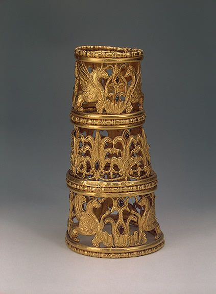 Cone with Griffins, Palmettes and Lotuses Gold, garnets and almandines; stamped, soldered, repousse and decorated with inlay. H. 19.3 cm Scythian culture. 4th - 3rd century BC Besleneyev Barrow No. 17, Kuban, Krasnodar Region, Besleneyevskaya Stanitsa (formerly Kuban Region) Russia Source of Entry: Imperial Archaeological Commission, St Petersburg. 1897. The State Hermitage Museum: Digital Collection