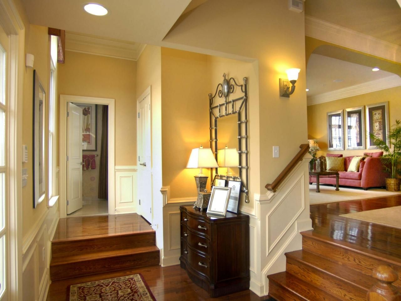 This foyer is a space all its own. Delineated by steps up to the ...