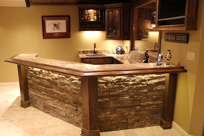 The Natural Wood Molding Beautifully Compliments The Intricately Textured Granite Countertops