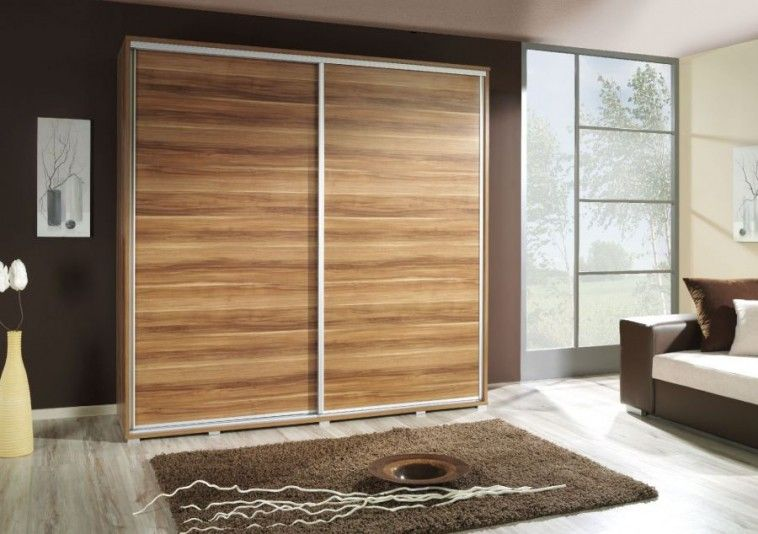 Brown Laminated Wooden Closet Door On Brown Painted Wall And Fur Ru