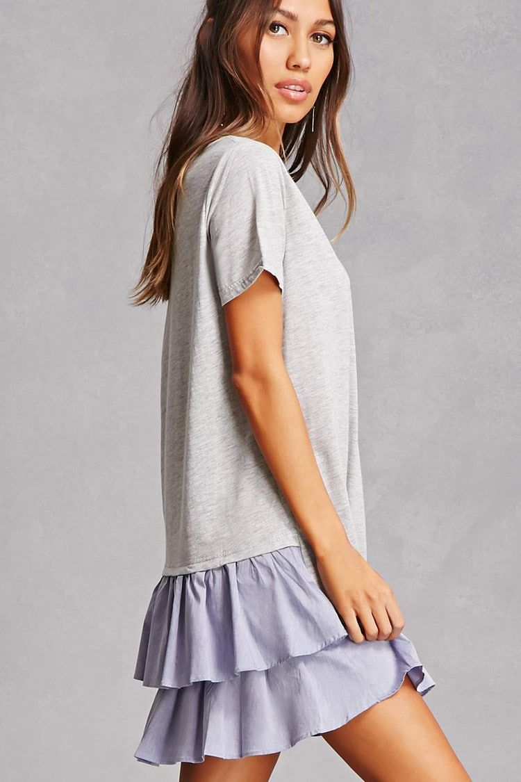 This knit mini tshirt dress features a shift silhouette crew neck