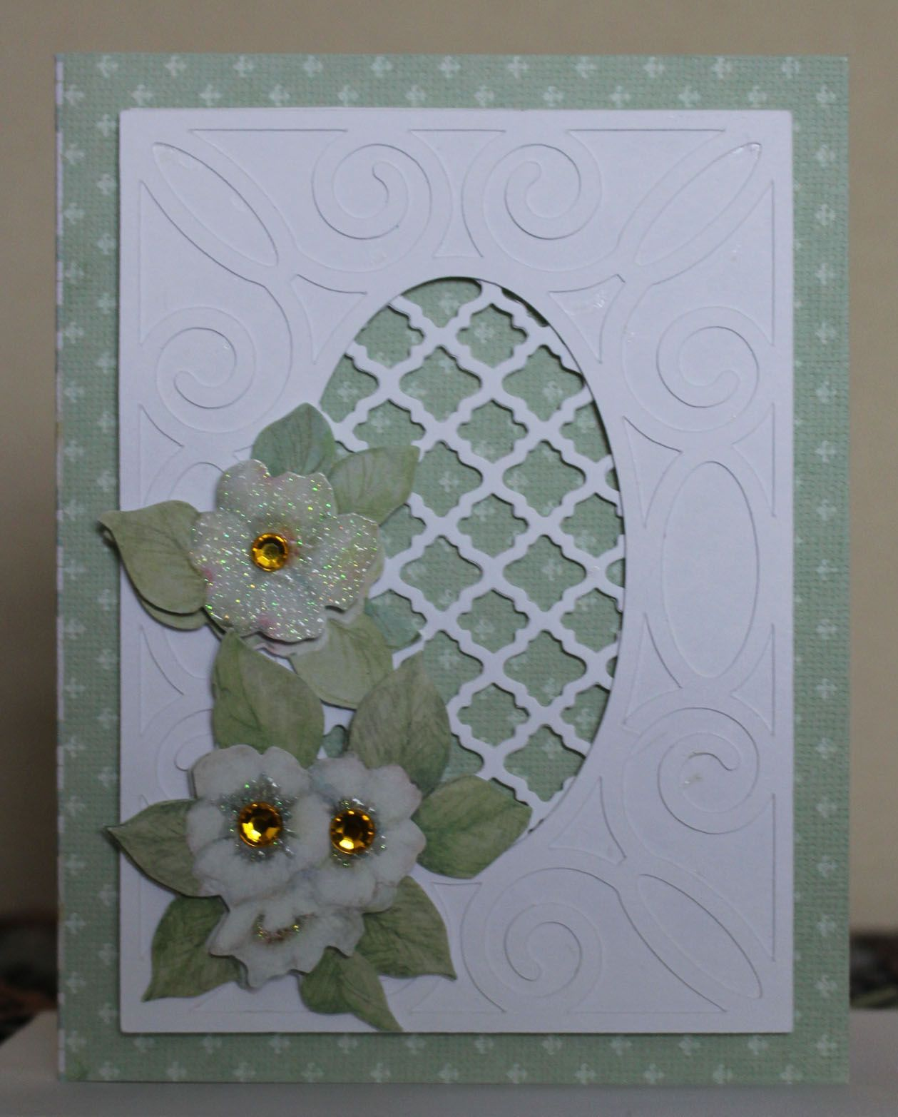 Heavier cardstock so used as a card base. Layers cut on my Silhouette machine. Flowers by K & Company,