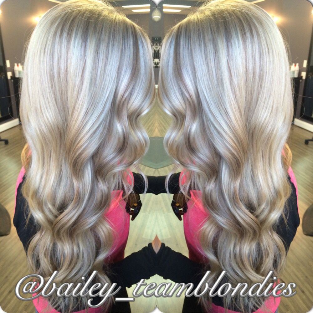 Beautiful platinum blonde with warm beige lowlights curled with
