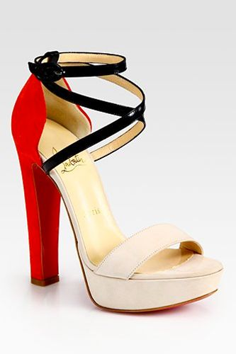 I'm a sucker for a sexy pair of heels. I don't know if it's just me, but I really don't like teensy stiletto heels. A thicker heel is way more attractive.   Christian Louboutin high heels available at Saks.