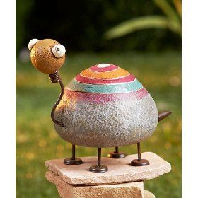 Rock Garden Friend is a fanciful way to decorate your front yard, backyard or deck/porch. This adorable garden figurine has a stone-like surface that's painted to look like an adorable creature, the Turtle. Metal accents give it extra charm.