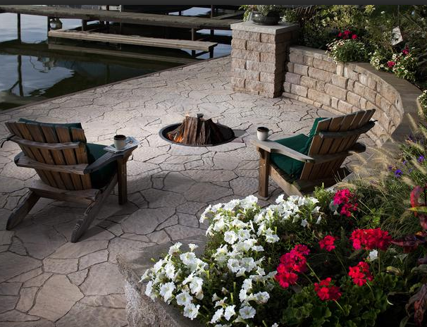 Lakeside Living...  Sometimes all you need is a stone fire pit, two Adirondack chairs and a lake view. For a completely natural look, nothing beats stone. Keep in mind, natural stone costs more because it is quarried and has to be trucked in, adding transportation costs.