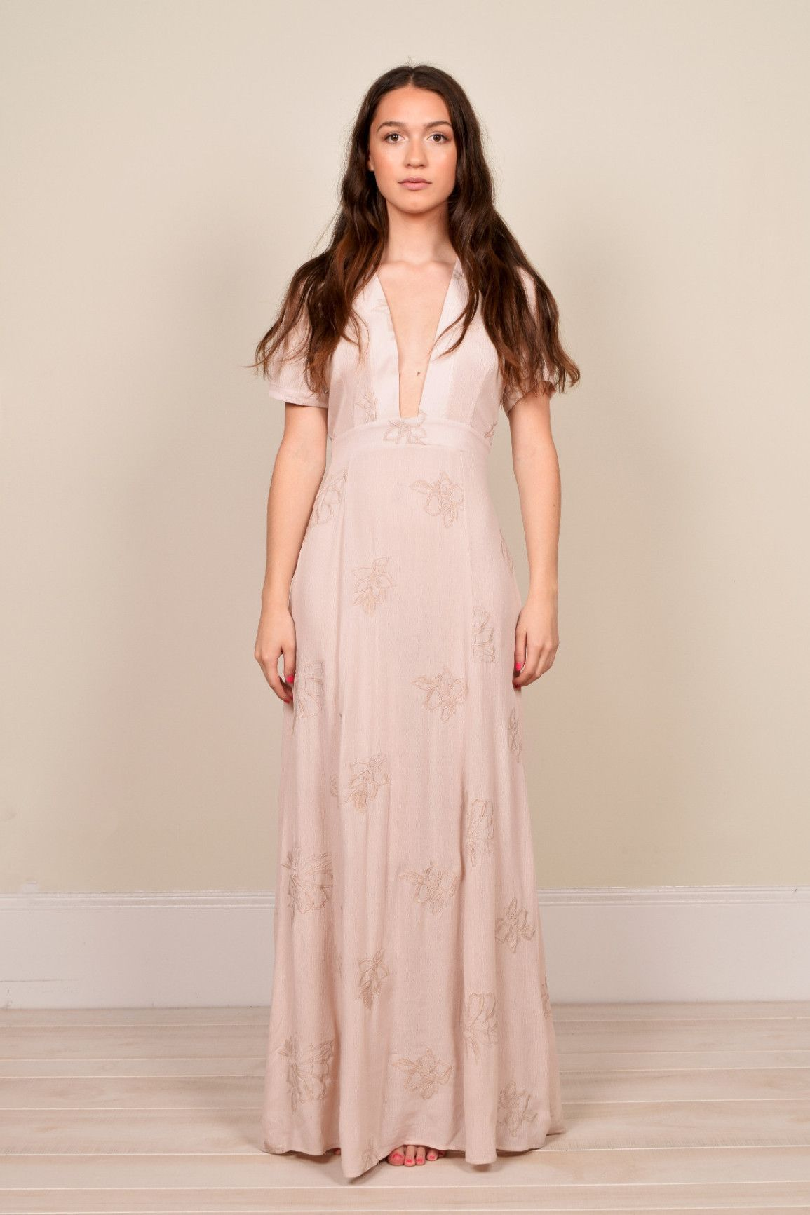Plunging maxi dress featuring a gorgeous embroidered floral print