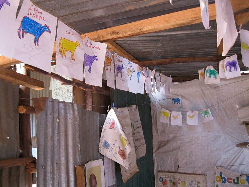 Artwork hanging from a classroom in the slum.