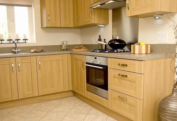 Light cream tiled floor, maple cabinets, light grey work ...