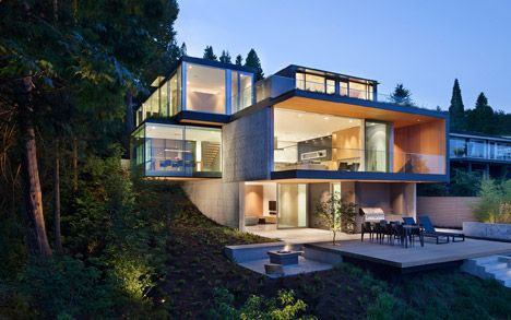 Protruding glass boxes offer ocean views this residence in Vancouver.