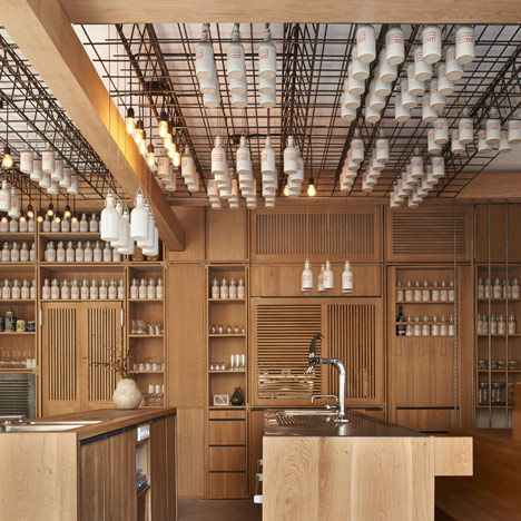 Buero Wagner Suspends Bottles Of Foraged Ingredients From