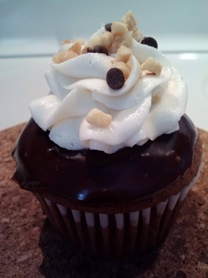 Rocky Road Cupcake- chocolate cake, marshmallow creme filling, chocolate ganache, vanilla frosting, topped with chopped nuts & mini chocolate chips