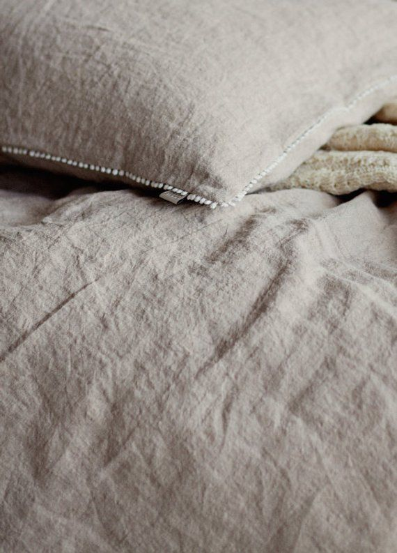 Photo of Linen duvet cover with pom pom trim. Washed linen bedding. King, queen, custom sizes.