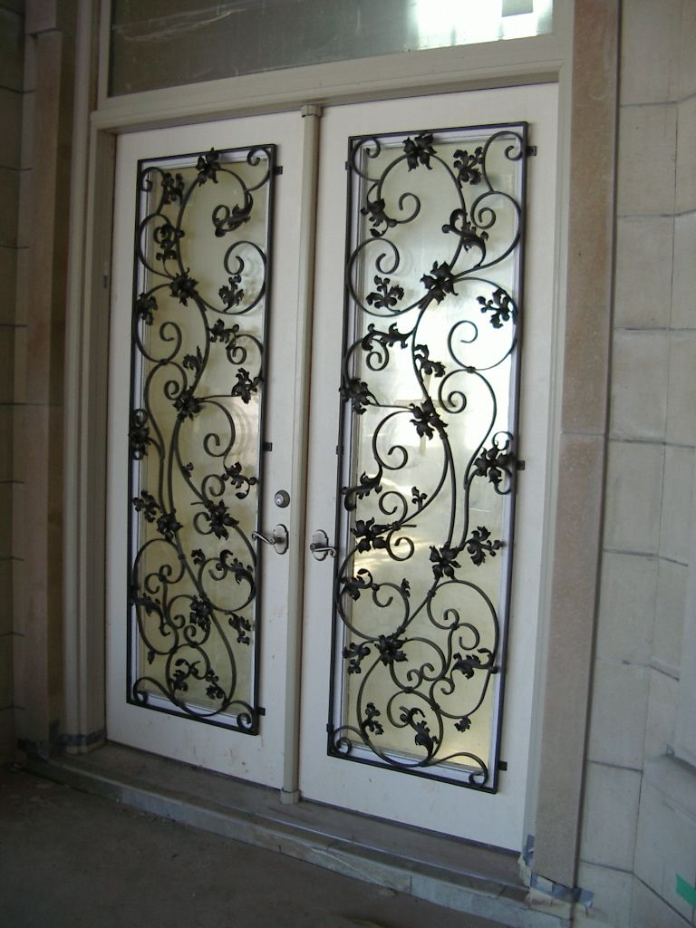 Iron work door artistic iron work door cover home for Wrought iron entry doors