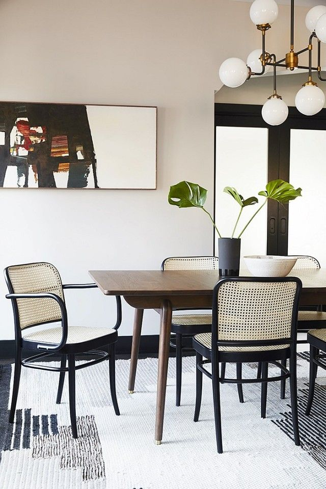 Bright Dinning Space With Retro Inspired Chairs And A Chandelier