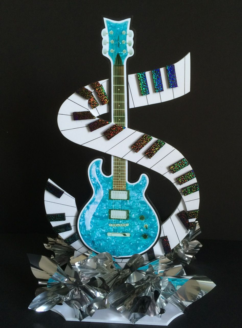 Two Sided Guitar With A Swirly Piano Keyboard With