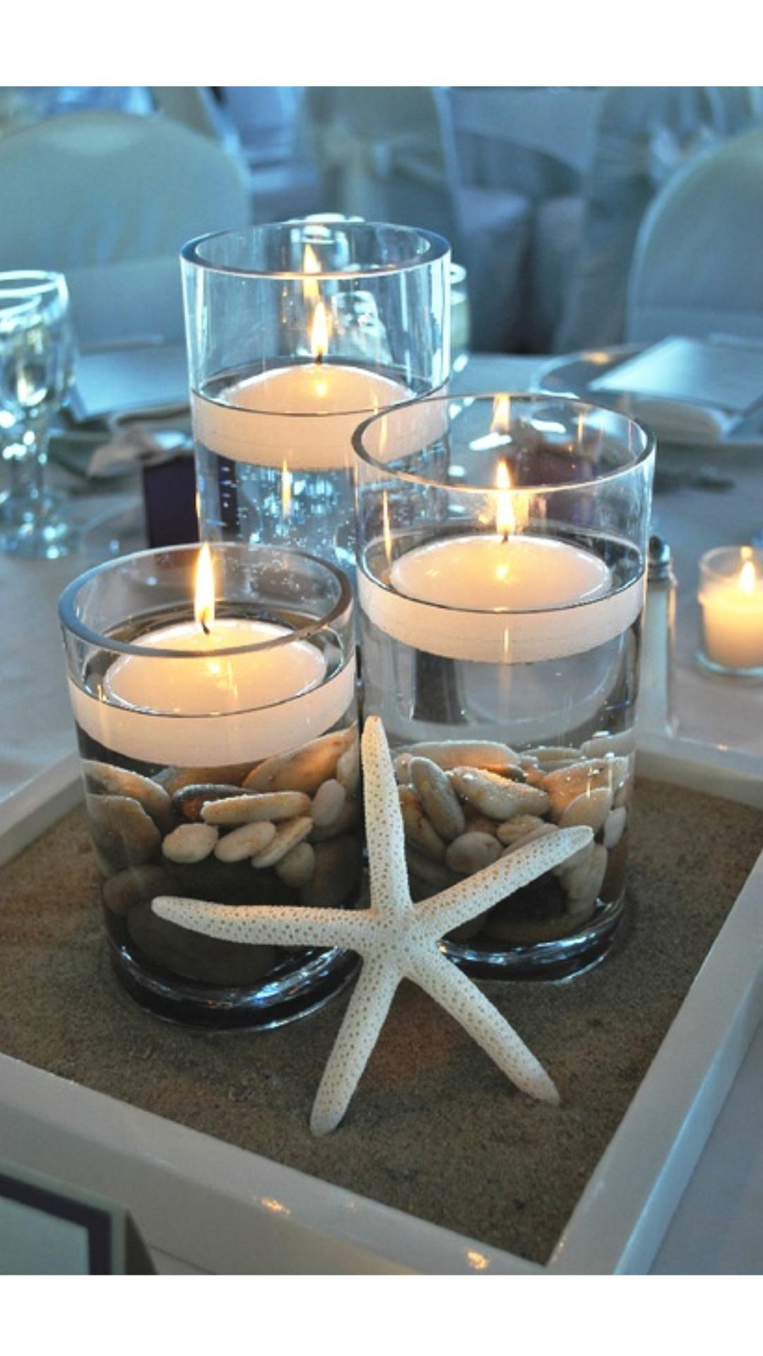 The candles...no the star Mesas de boda, Centros de mesa