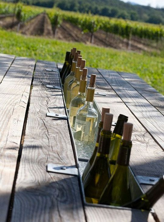 Gutter filled with ice down the middle of a picnic table---clever way to keep drinks cool!
