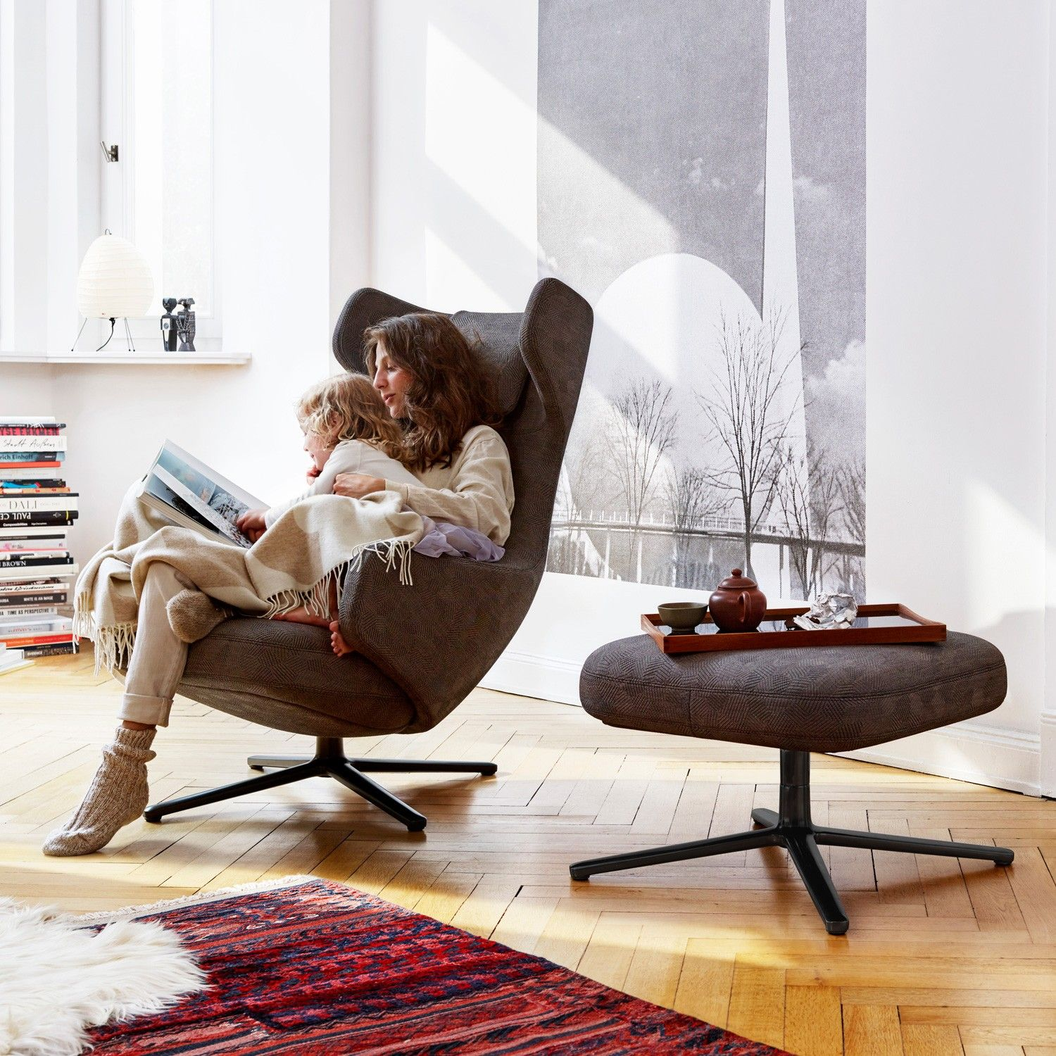 Grand Repos & Ottoman by Antonio Citterio for Vitra is a stunning winged head rest lounge chair with ac panying ottoman for the ultimate in luxury