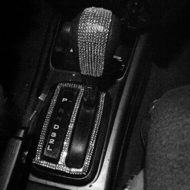 Rhinestone car interior with a jeweled clutch! Love!
