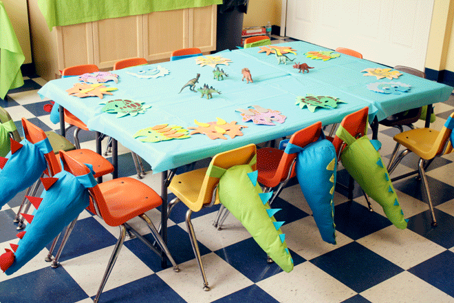 Fantastic dinosaur chairs that turn into a costume later by tying them around their waist and adding the dinosaur mask.