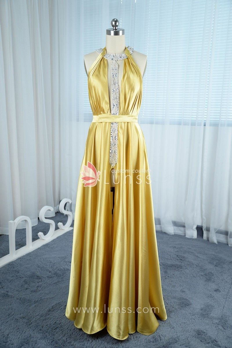 This eyecatching gold long prom dress is made of lustrous charmeuse