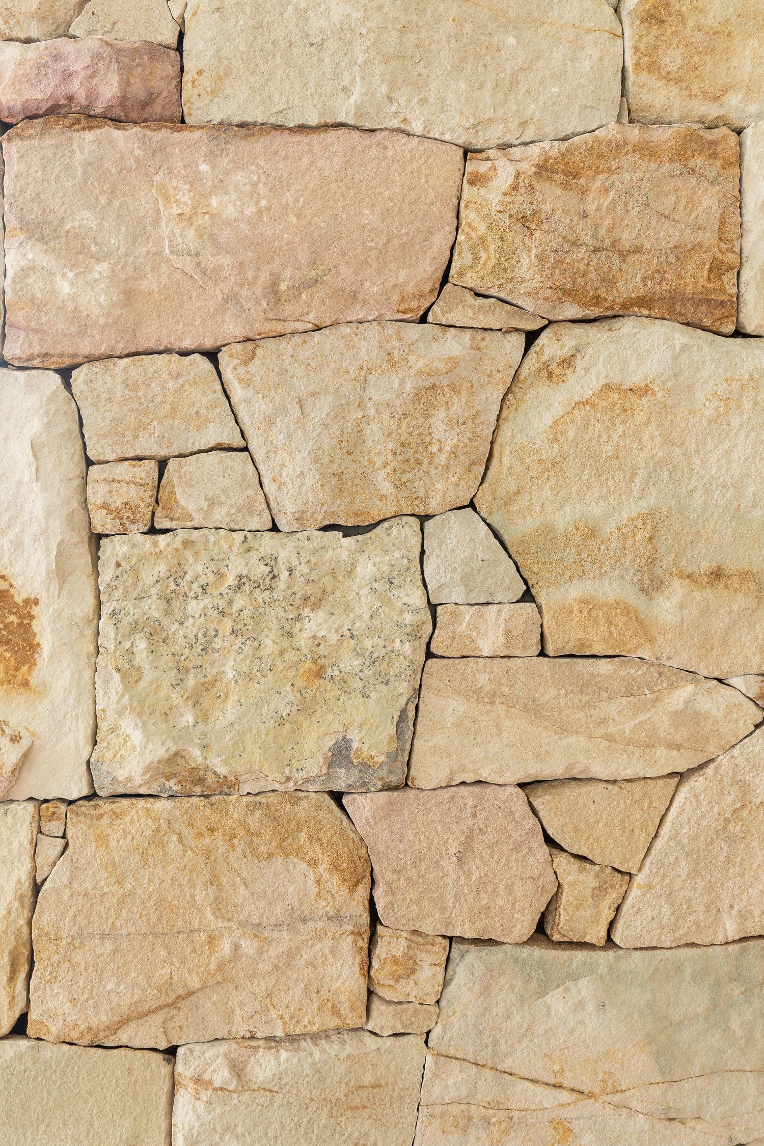 Cylinders Stone Style In 2020 Sandstone Wall Outside House Colors Contemporary Beach House