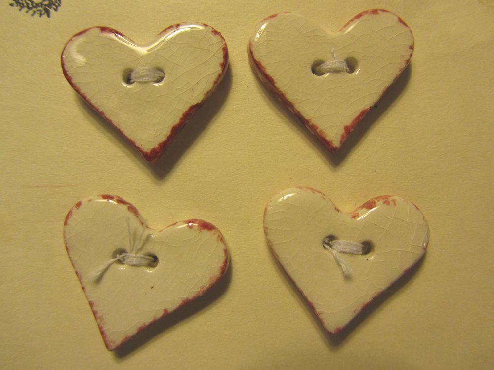 4 - A HOMESPUN HEART RED EDGE WHITE HEART SHAPE CERAMIC BUTTONS- VINTAGE Lot#J81