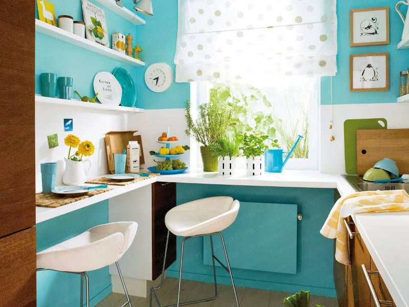 """An uber small kitchen gets a makeover with a coat of turquoise blue paint and a bar area for cozy dining.""  Before and after photos at the click-through."