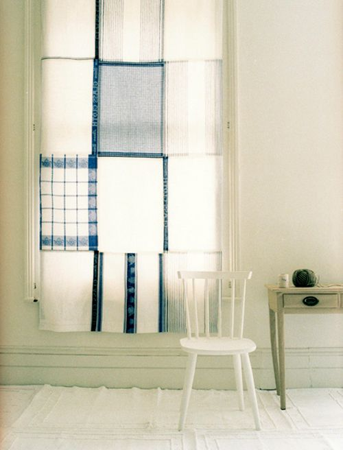 Curtain made from tea towels. This would be sweet in a kitchen or for a back door!