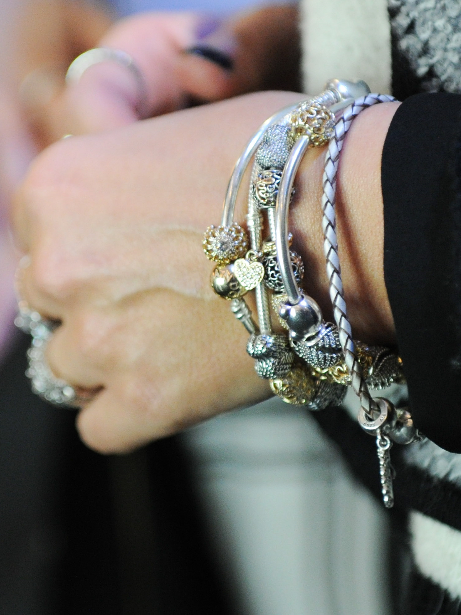 Closeup of janette ewenus amazing pandora bracelet stack