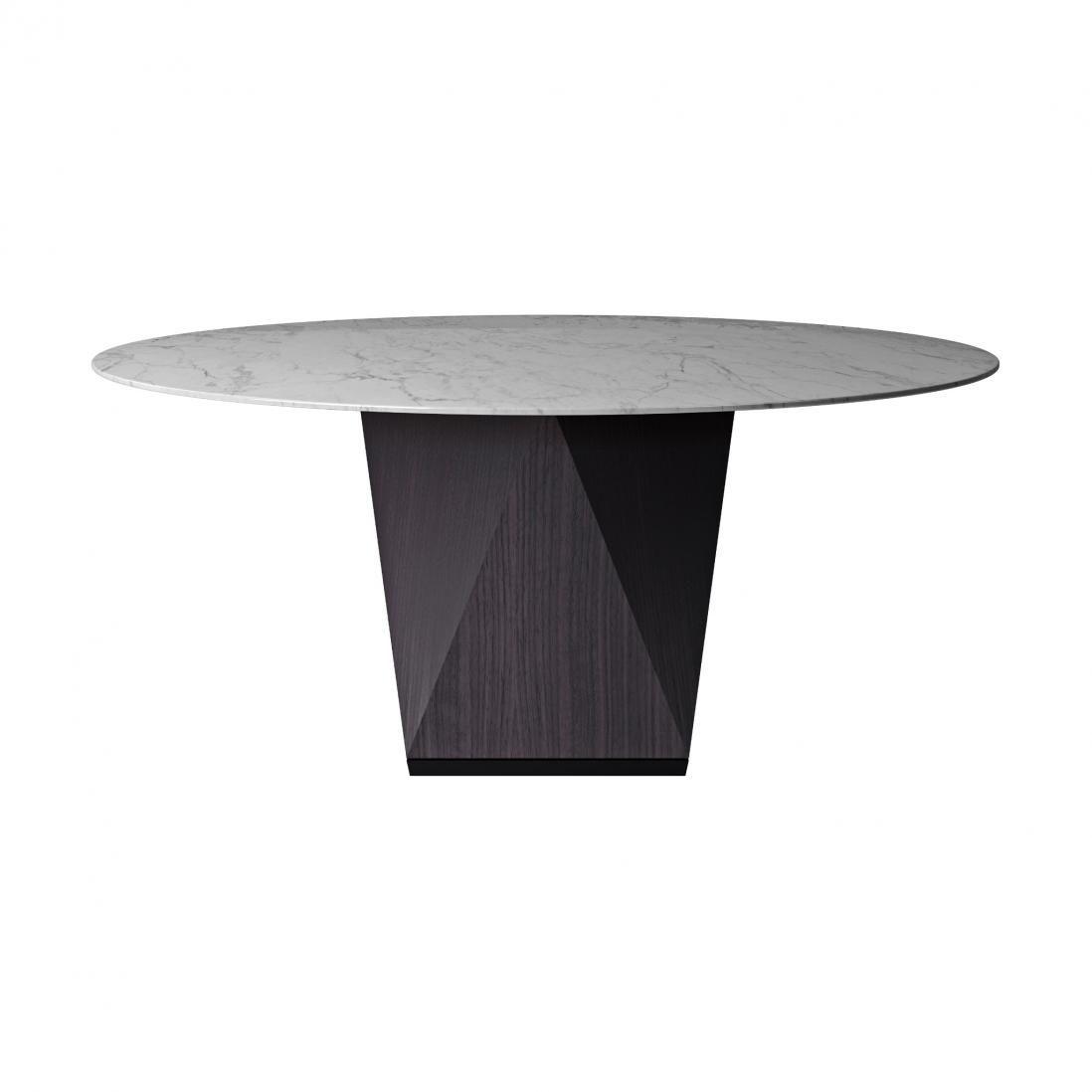Tavolo Con Piede Centrale un tavolo scultoreo ma leggero, in cui la gamba centrale