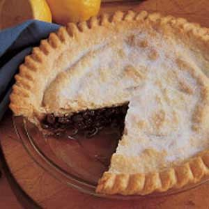 """Grandma Meg's Raisin Pie Recipe -Whenever I bake this pie, I think of the days of the Depression. Meat was hard to come by then, so Grandma Meg would tell my dad, """"If you go hunt for a rabbit or peasant for Sunday dinner, I'll make a raisin pie."""" We had lot of wild game and raisin pies during those days!"""