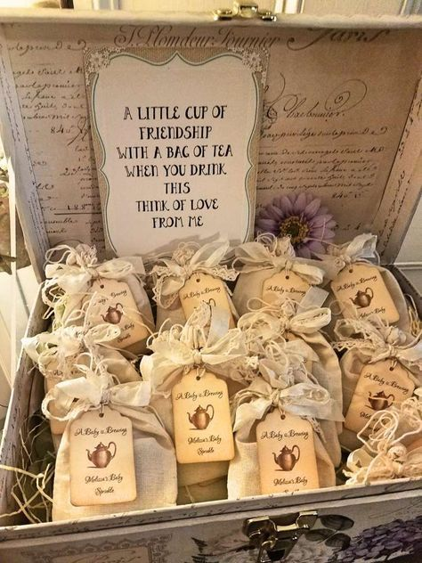 The little party favor bags with tea for guests is such a cute idea for a tea pa... -