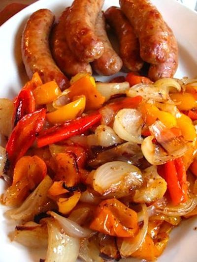 Roasted sausages with peppers and onions is a quick-to-make sheet pan dinner that cooks in half an hour with so much flavor you may be scraping the pan.