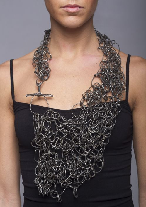 Steel mesh necklace with hand-formed links and asymmetrical structure; contempor…