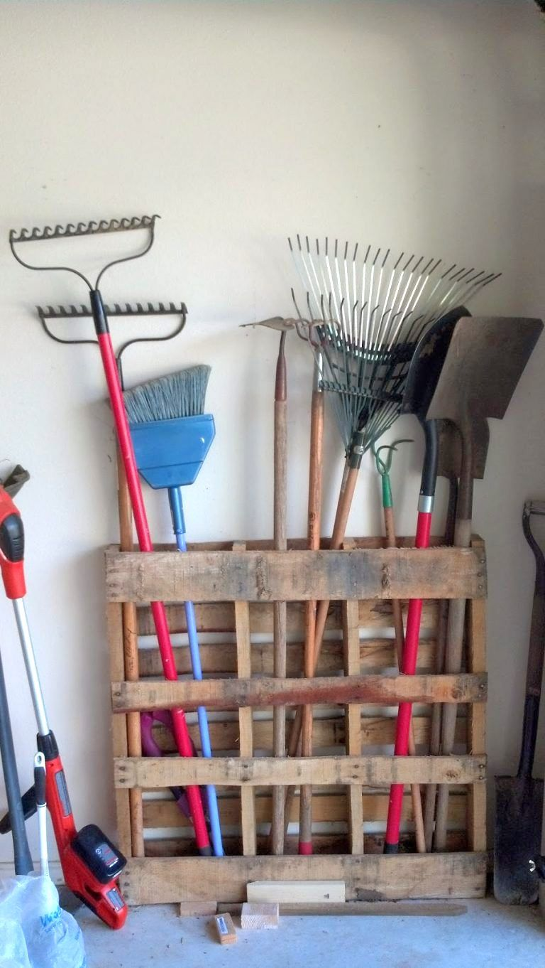 7 Totally Feasible Ways To Be More Organized This Week Stand An Old Wood Pallet On Its Side For Instant Garage Organization