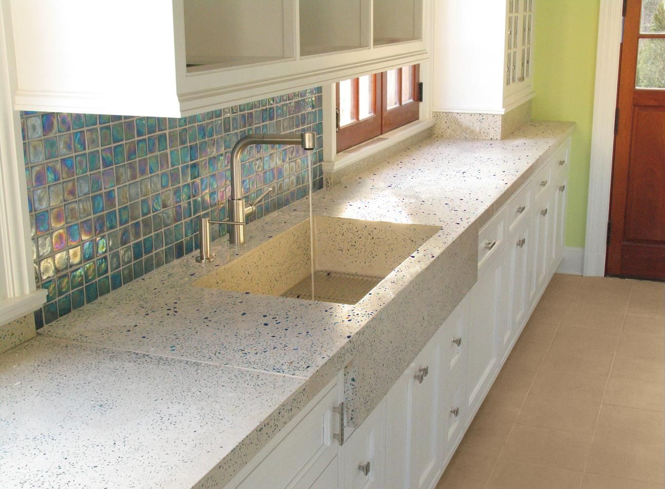 Beautiful kitchen with concrete counters and sink and abalone ...