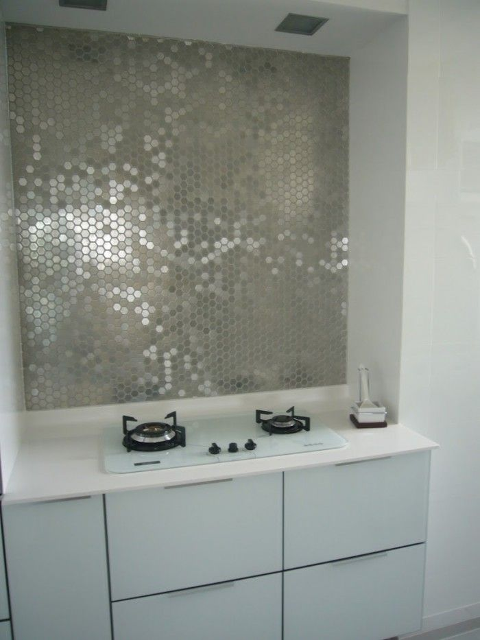 funky metallic mirrored tile kitchen backsplash and white kitchen
