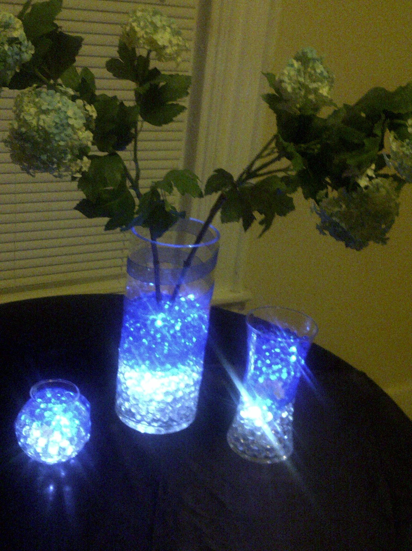 I love doing centerpieces at home did this with material i had like the way theres lights in the rocks without the boring flowers reviewsmspy