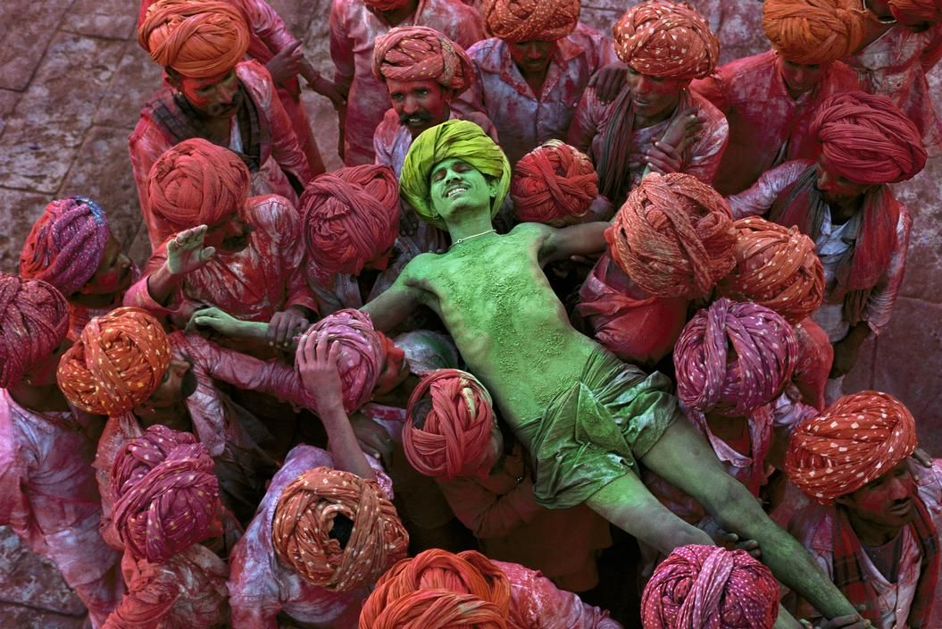 Steve McCurry  INDIA. Rajasthan. 1996. Villagers participating in the Holi Festival.