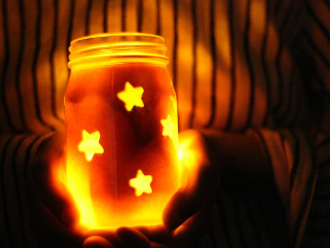 Spray paint over stickers on mason jars to create festive luminaries! Great idea for any event!