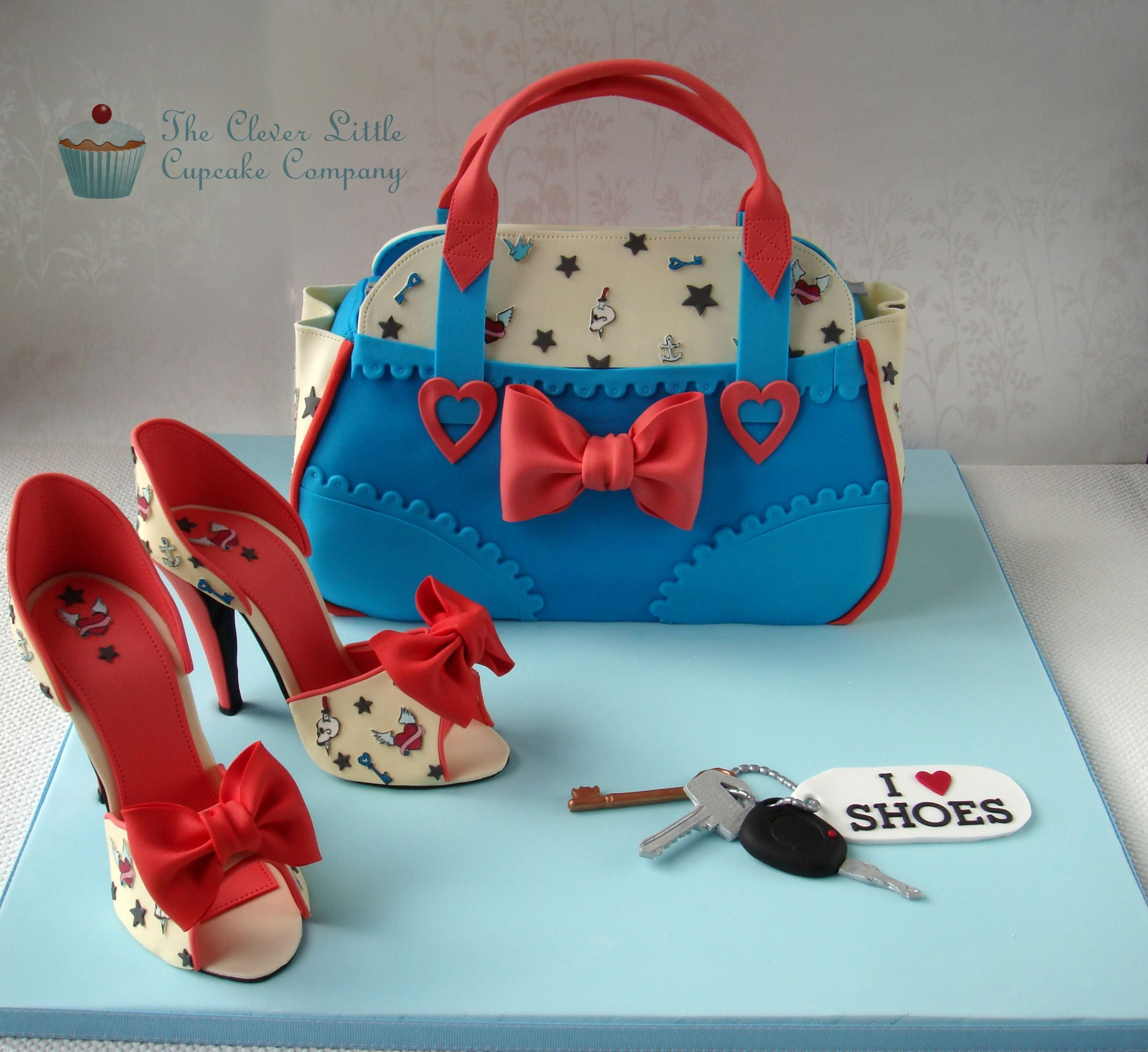 Cake International (Birmingham UK) entry - Shoes and Handbag - All edible with no supports.  The tattoo icons on the shoes and bag were hand painted and hand cut.  I won a gold medal at the competition for this entry! x