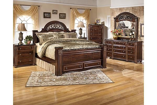 The Gabriela Poster Bed W Storage From Ashley Furniture Homestore Afhs Com With Elegant Detailing And Rich Inviting Finishes The Old