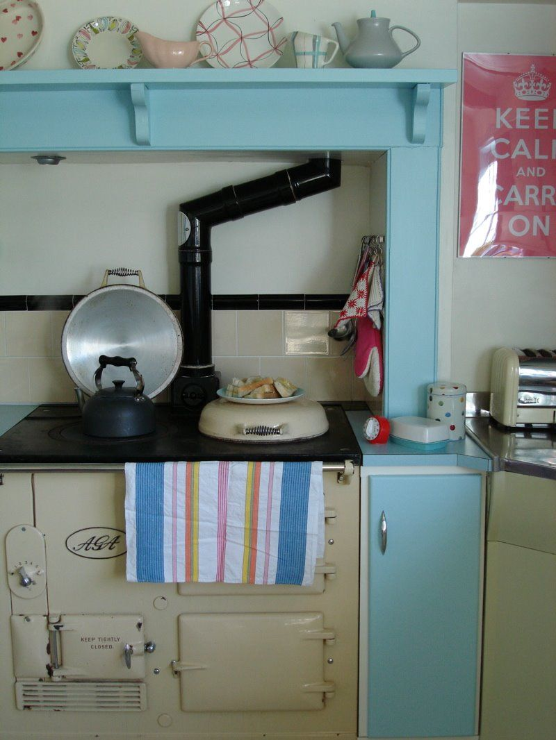 three small kitchens with aga ranges