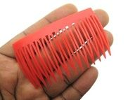 I had a bunch of these hair combs, but I never really knew why. I don't think I ever actually wore them.