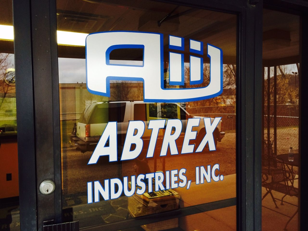 Abtrex Industries, Inc. window graphics for their storefront.