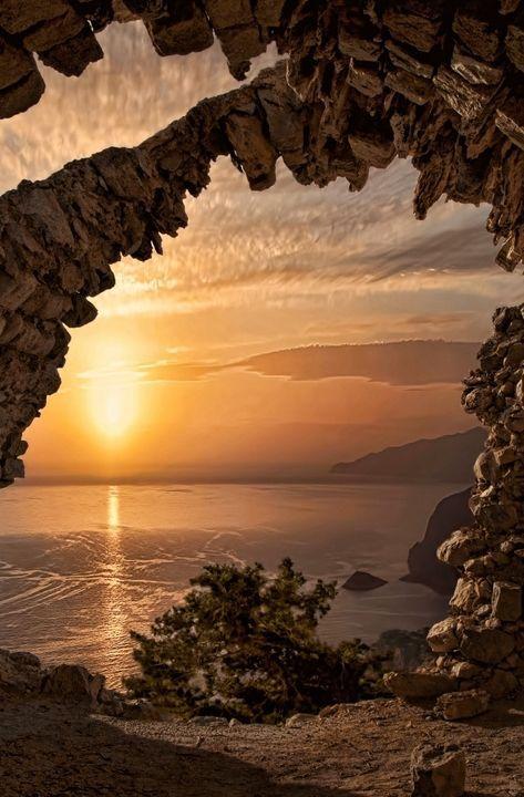 Sunset from the Castle of Monolithos - Rhodes, Greece. https://ExploreTraveler.com