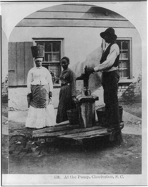 African Americans working, Charleston, S.C.: At the pump - 3 African Americans at water pump. c.1879
