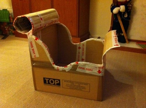 How to Make a Cardboard Santa Sleigh Out Of #christmasdoordecorationsforschool
